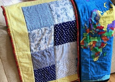 Joyce Donaldson - Baby Quilt with Map of the World back