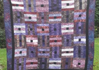 Lorna Lafferty - 'Plumb Pudding' quilted by Liz Dunne